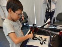 Японский робот научит детей каллиграфии