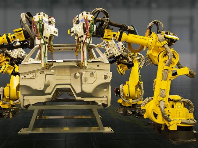 Роботы FANUC работают на заводе AUDI в Венгрии практически без остановки