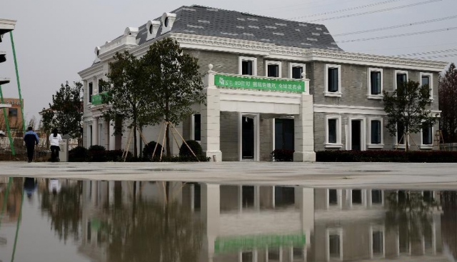 WinSun China builds world's first 3D printed villa and tallest 3D printed apartment building
