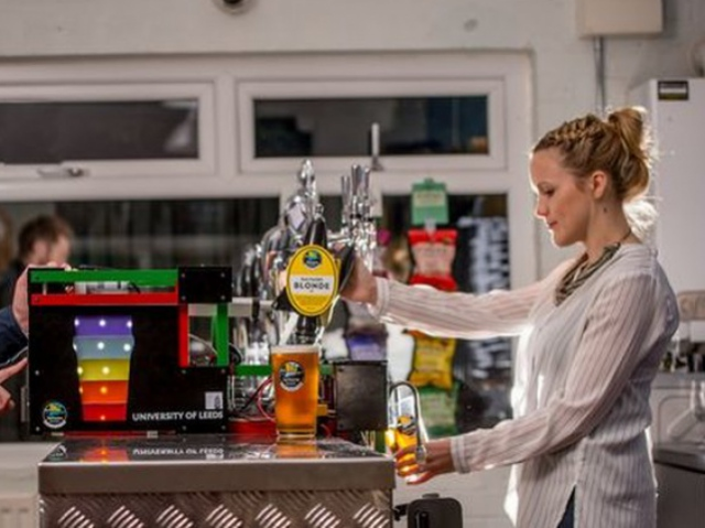 A British robot bartender pouring the perfect beer